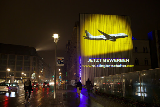 In this image Vueling leverages the unique guerrilla marketing technique of inserting a guerilla projection on a building